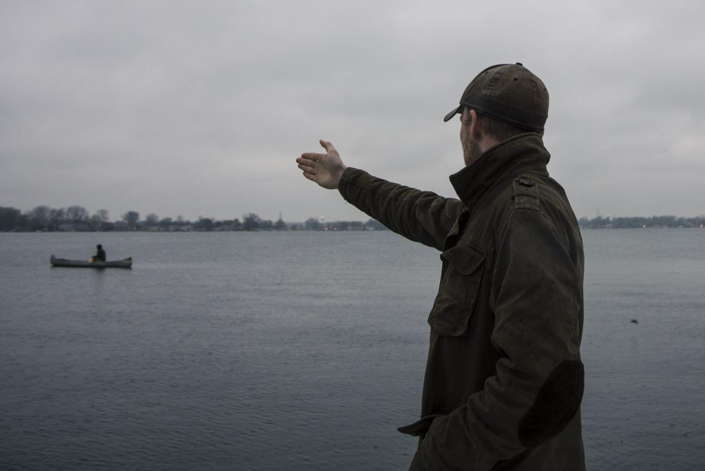 Hanson directing a boat into position for a shot over the lake